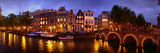 Buildings Along a Canal at Dusk, Amsterdam, Netherlands Stampa fotografica