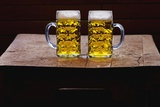 Two Glass Mugs of Beer on Table Photographic Print by Bruno Ehrs