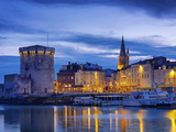 France, Poitou-Charentes, La Rochelle, Town Reflected in Harbour at Dusk Photographic Print by Shaun Egan