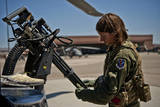 Airman Examines the Barrels of a Gau-2 Mini Gun on an Hh-60 Pave Hawk Photographic Print