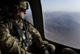 U.S. Army Soldier Looks Out the Window of a Uh-60 Black Hawk Helicopter Fotoprint