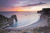 A Colourful Sunset over Durdle Door Fotografisk trykk av Julian Elliott