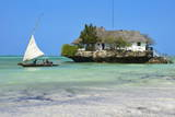 Tourist on a Traditional Dhow Boat, the Rock Restaurant, Bwejuu Beach, Zanzibar, Tanzania Photographic Print by Peter Richardson