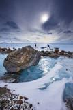 Expedition team members trek over blue glacial ice. Fotografie-Druck von Cory Richards