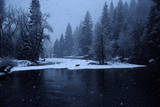 A Mule Deer Walks Along the Merced River in a Snow Storm at Twilight. Photographic Print by Marc Moritsch