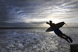 A Surfer Jumps into the Sea at the Beachfront in Durban, South Africa Fotografie-Druck von Kim Ludbrook