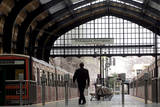A Security Guard Walks on the Empty Platform at the Electric Trains Station in Piraeus, Greece Photographic Print by Orestis Panagiotou