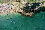 Italia, Apulia, Polignano a Mare. Crowded beach on a weekend. green. Photographic Print by Michele Molinari
