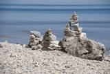 USA, Michigan. Stone towers on the beach of Mackinac Island. Photographic Print by Anna Miller