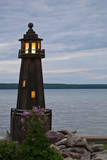 USA, Michigan. Yard decoration lighthouse on Munising Bay. Photographic Print by Anna Miller