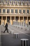 A man walks across the courtyard of Palais Royal, Paris, France Fotografisk trykk av Brian Jannsen
