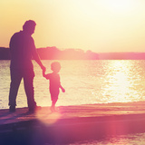 Father and Son Walking Out on a Dock at Sunset Photographic Print by  soupstock