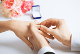 Picture of Man Putting Wedding Ring on Woman Hand Lámina fotográfica por  dolgachov