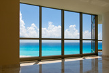 View of Tropical Beach Through Hotel Windows Fotografie-Druck von  nfsphoto