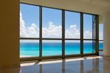 View of Tropical Beach Through Hotel Windows Stampa fotografica di  nfsphoto