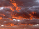 Cumulus clouds at sunrise. Fremont River Valley. Utah, USA Photographic Print by Scott T. Smith