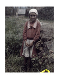 A Young Girl from a Farm Community Poses, Leaning Against a Rock Fotoprint av Wilhelm Tobien