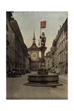 The Zahringer Brunnen Fountain before the Zeitglockenturm Clock Tower Photographic Print by Hans Hildenbrand