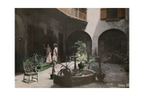 Two Women Talk in a French Quarter Courtyard Reproduction photographique par Edwin L. Wisherd