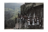 A Large Group of People Stand on a Balcony in Traditional Costume Fotografisk tryk af Hans Hildenbrand