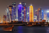 The Colorful Modern Skyline of Doha, on the Persian Gulf, Contrasts with Traditional Fishing Boats Fotografisk tryk af Babak Tafreshi
