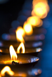 A Candle Flickers in a Brass Butter Lamp in the Prayer Room of an Ancient Buddhist Monastery Photographic Print by Jason Edwards