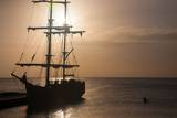 A Two Masted Brig with Furled Sails Docked in the Harbor of George Town Stampa fotografica di Matt Propert