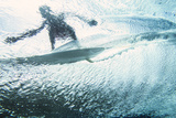 Underwater View of a Surfer on the Water's Surface Stretched Canvas Print by Andy Bardon