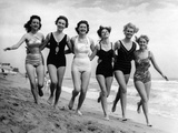 Six Women, in Swimsuits, Run in a Row Along a Beach, 1942 Photographic Print