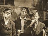 Newsboys Having a Smoking Break, St. Louis, Missouri. 1910 Photographic Print by Lewis Wickes Hine