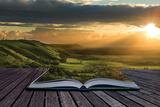 Magical Book With Contents Spilling Into Landscape Background Plastikschild von  Veneratio