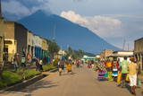 Little Village before the Towering Volcanoes of the Virunga National Park, Rwanda, Africa Fotografisk tryk af  Michael