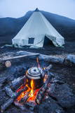 Boiling Water Pot over an Open Fire on a Campsite and Tipi on Tolbachik Volcano Photographic Print by  Michael