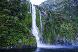 Huge Waterfall in the Milford Sound Photographic Print by  Michael