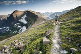 A Woman Trail Running High in Glacier National Park, Montana Photographic Print by Steven Gnam