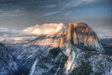 Yosemite National Park, California: Clouds Roll in on Half Dome as Sunset Falls on the Valley Fotoprint van Brad Beck