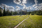 A Young Woman Trail Running in Glacier National Park, Montana Lámina fotográfica por Steven Gnam