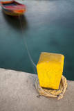 A Yellow, Single Dock Support, Knotted with Rope, Attached to a Blurred Boat in the Caribbean Sea Reproduction photographique par Patrick Brandenburg