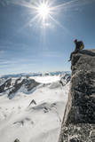 A Young Male Climber on the Summit of Pigeon Spire, Bugaboos, British Columbia Fotografisk trykk av Steven Gnam