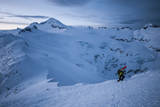 A Male Snowboarder in the Backcountry of North Cascades National Park, Washington Photographic Print by Steven Gnam