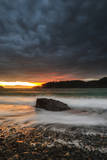The Sun Sets Through the Clouds at Deception Pass State Park in Washington Photographic Print by Jay Goodrich