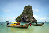A Longtail Boat Floats Off Shore of Pranang Beach - Railay, Thailand Photographic Print by Dan Holz