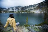 A Woman Sits at Dusk Near Mirror Lake in the Wallowa Mountains in Northeast Oregon Photographic Print by Ben Herndon