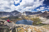 A Young Female Hiker Enjoys a Rest During a Day Hike Up Pyramid Peak, at Pyramid Lake, Wyoming Photographic Print by Ben Herndon