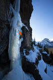 A Male Ice Climber Climbs the Scepter, a Hyalite Canyon Classic, During a Bluebird Day in Montana Photographic Print by Ben Herndon