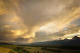 A Heavy Thunderstorm over Jackson Hole, Wyoming from the Teton Mountains, Grand Teton National Park Impressão fotográfica por Mike Cavaroc