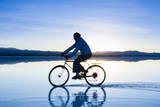 A Young Woman Rides Her Mountain Bike on the Flooded Salt Pan of the Salar De Uyuni in Sw Bolivia Reproduction photographique par Sergio Ballivian