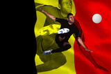 Football Player in Black Kicking against Belgium Flag Impressão fotográfica por Wavebreak Media Ltd