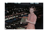 A Young Girl Removes Raw Fiber from Spools to Spindles for Weaving Photographic Print by J. Baylor Roberts