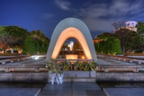 Cenotaph through Which the Atomic Dome Can Be Seen at at Peace Memorial Park in Hiroshima, Japan. Photographic Print by  SeanPavonePhoto